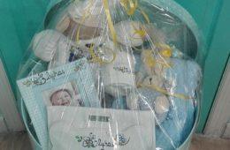 Canastilla bebé personalizada. (Detalle de presentación).