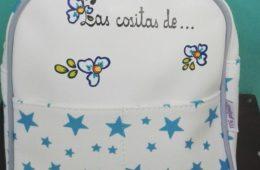 Mochila estrellas en azul con el nombre del niño.